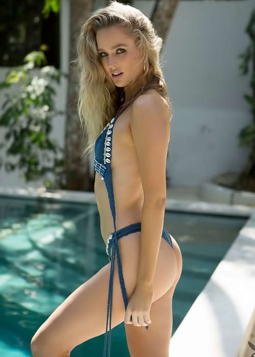 Blonde seductress by the pool