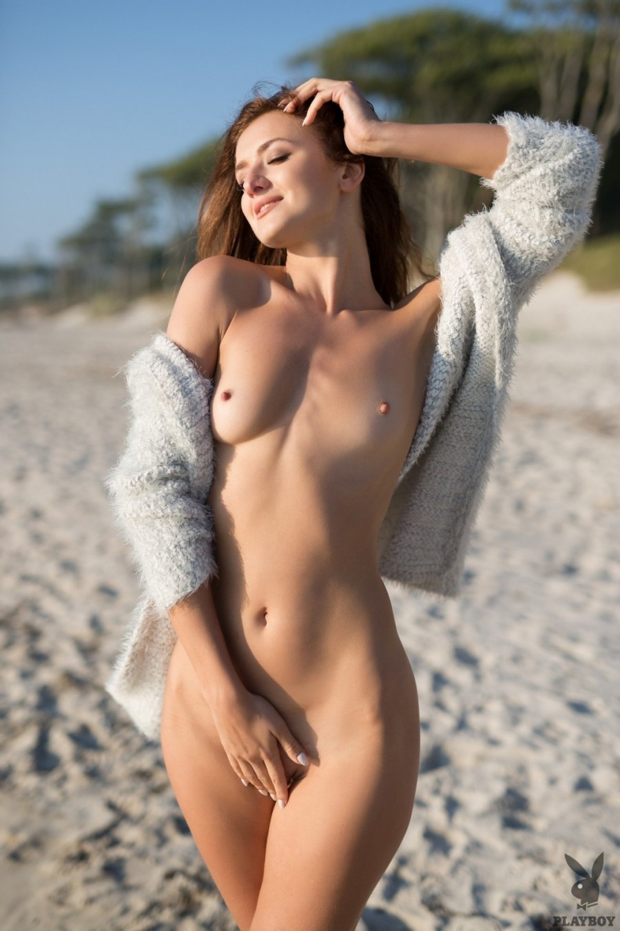 Brunette spends morning on beach
