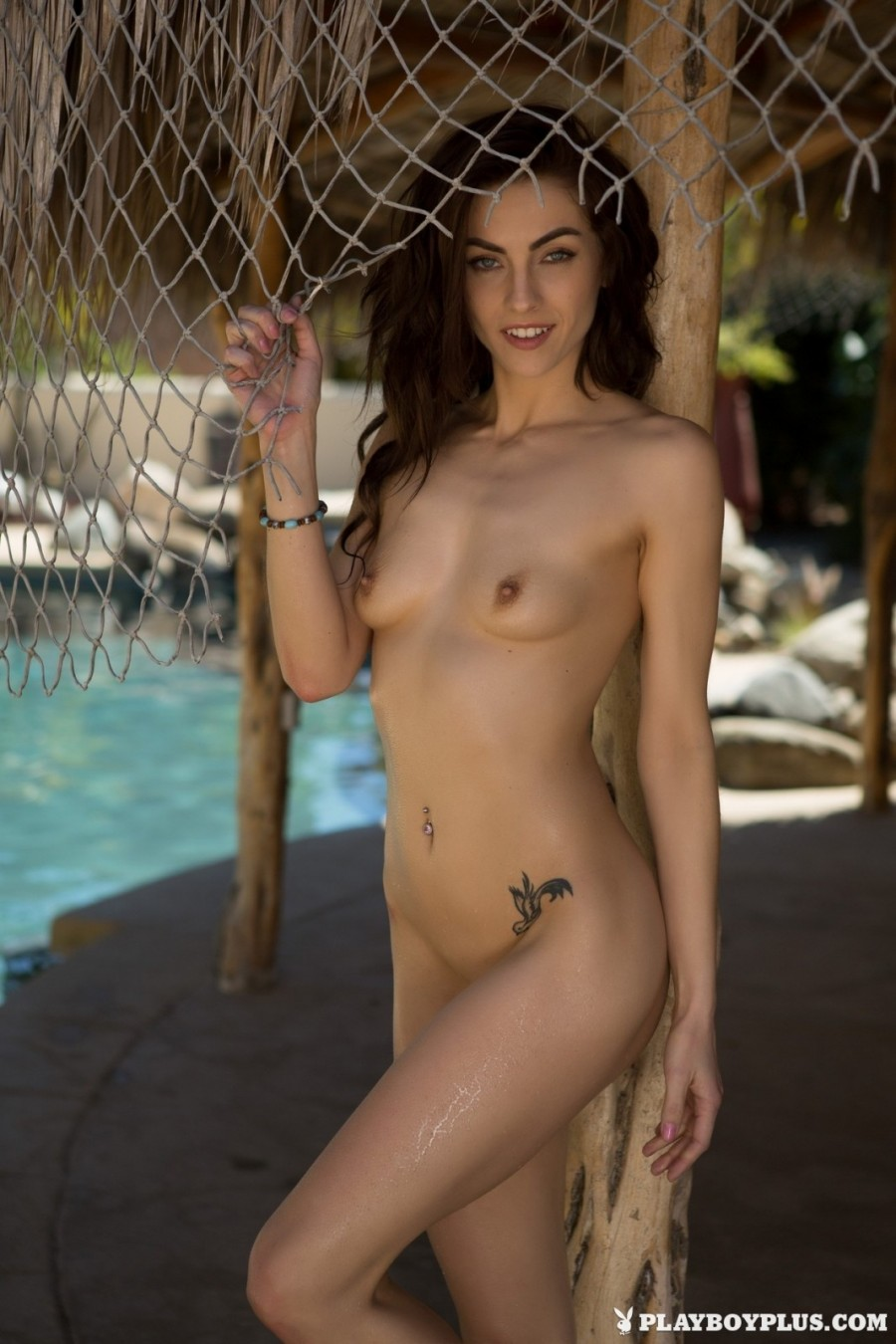 Brunette model shows off nude outdoors