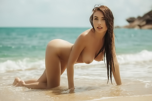 Brunette sweetie naked on the beach
