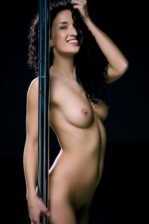Fit, gorgeous dancer works the pole