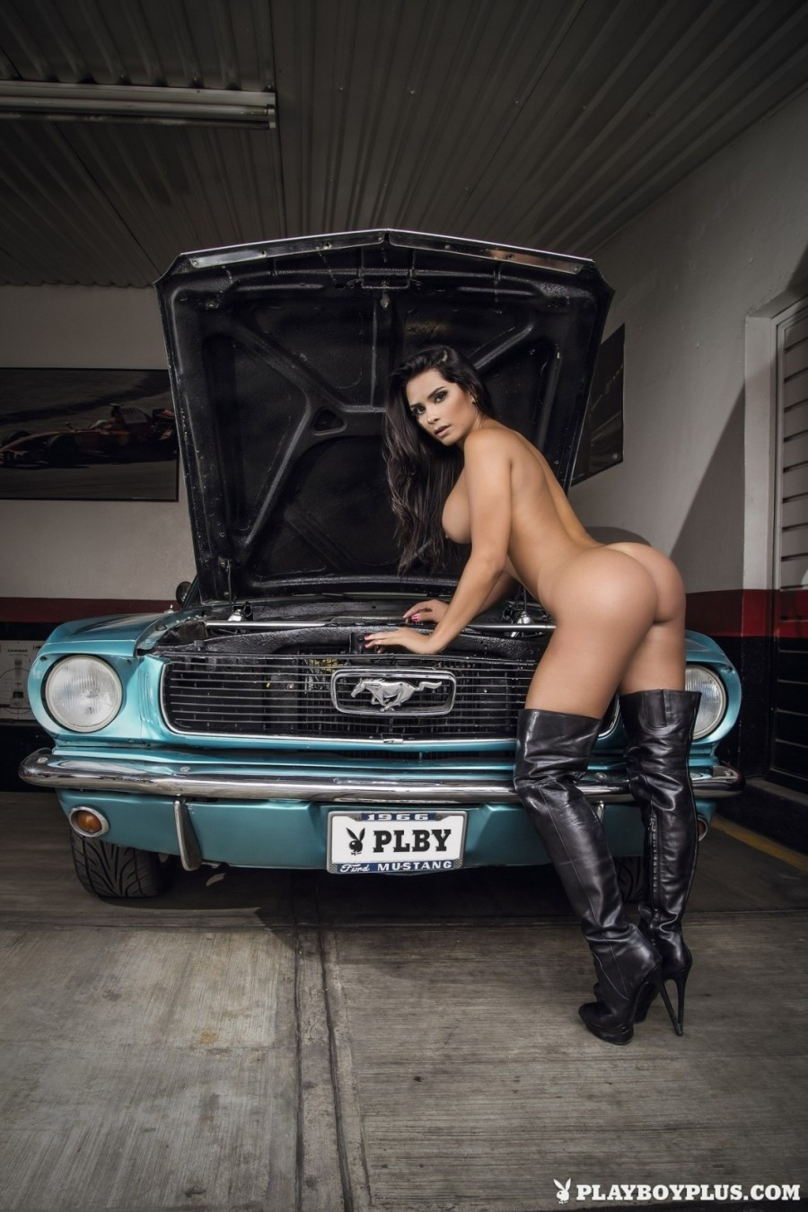 Burning hot brunette strips in garage
