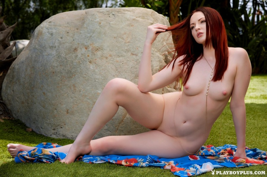 Brunette gets solo orgasm in a park