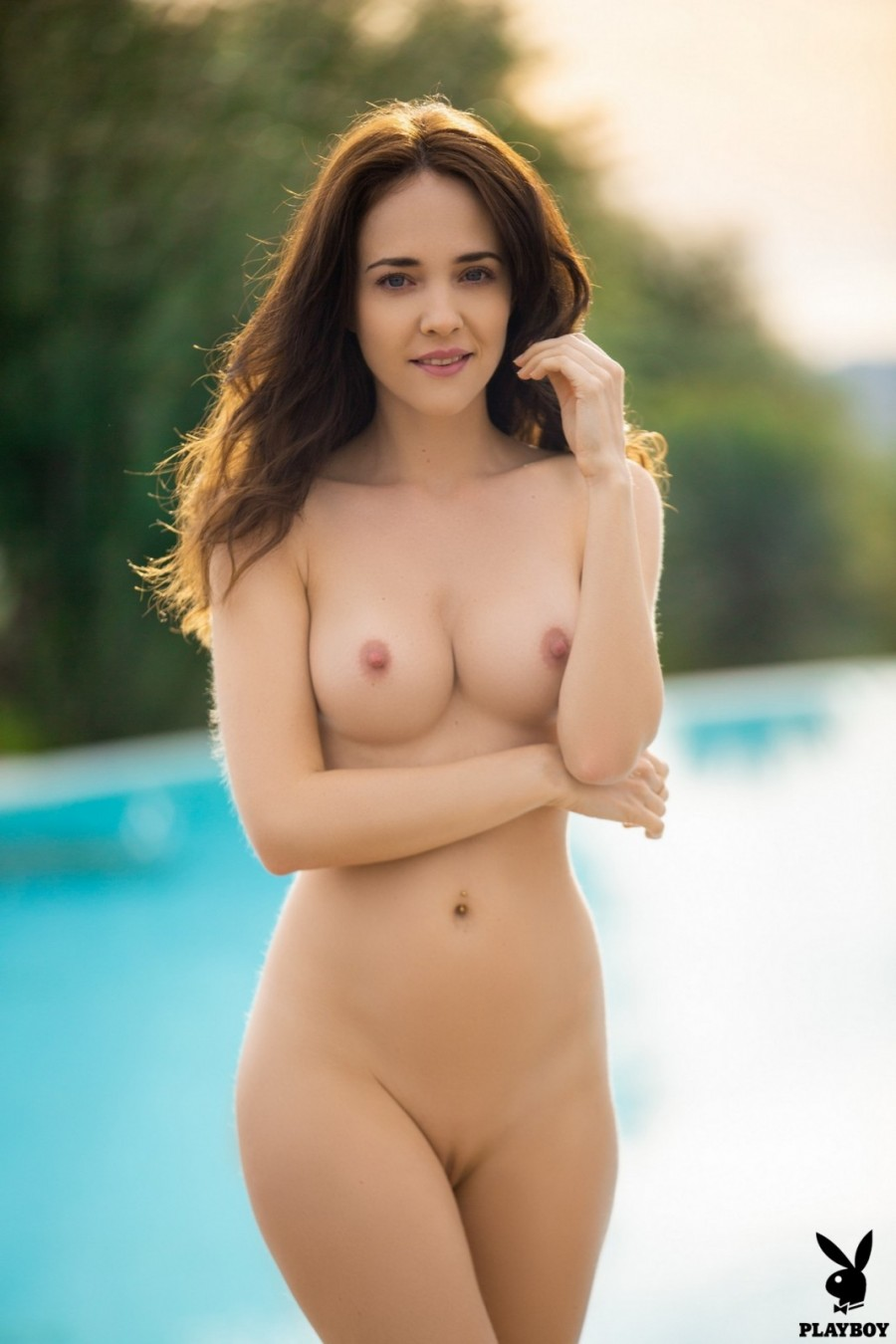 Busty hottie swims naked in pool