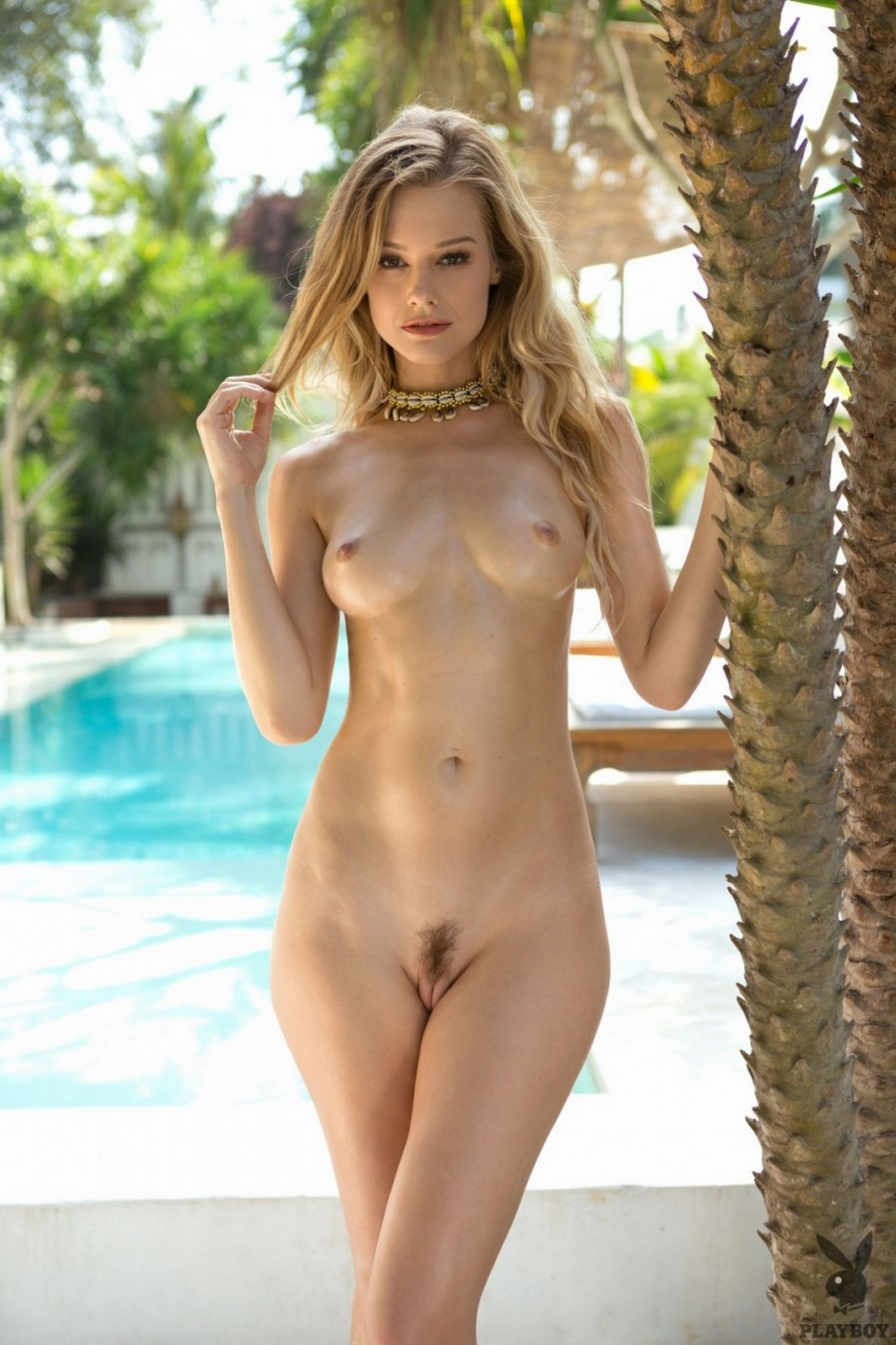 Delightful blonde got nude by the pool