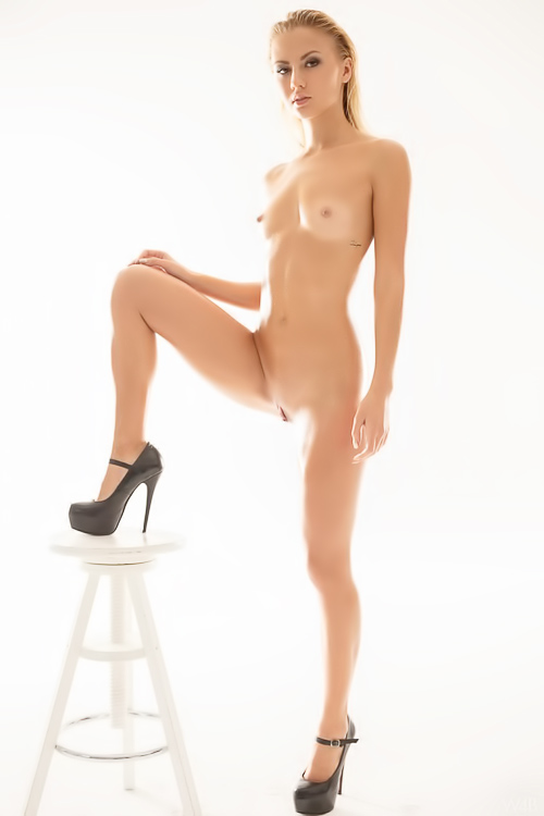 Oiled up blonde in just high heels