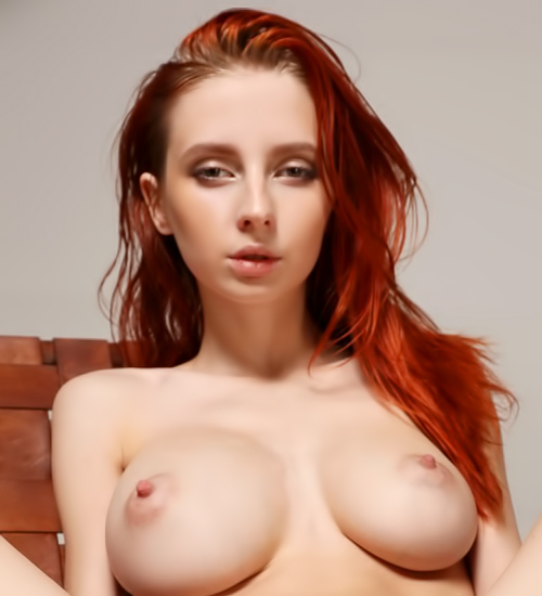 Skinny redhead with huge tits