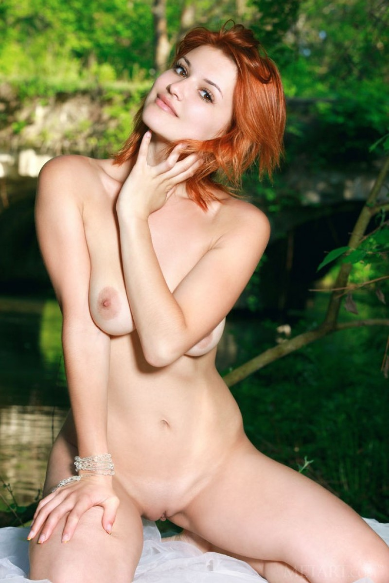 Big natural tits on a redhead outdoors
