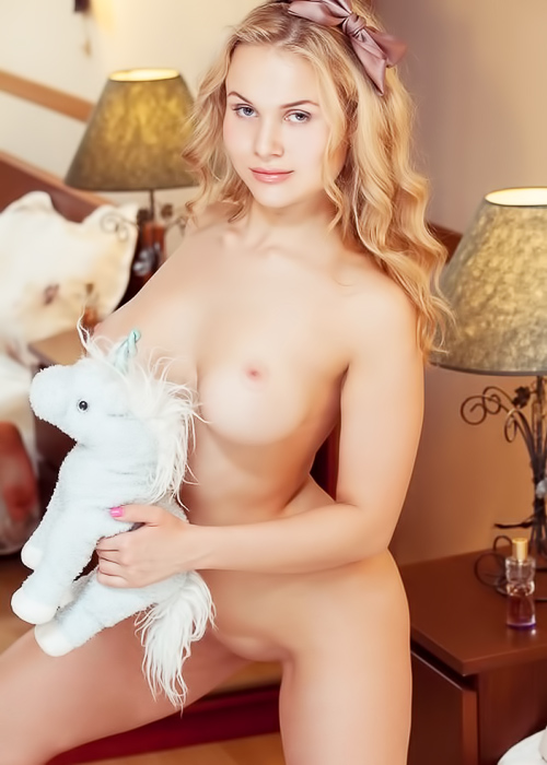 Curvy, busty blonde takes it off