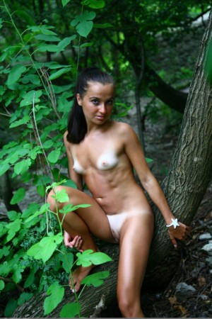 Naked babe works out in the forest