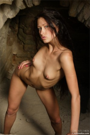 Naked dark-haired hottie explores the ruins