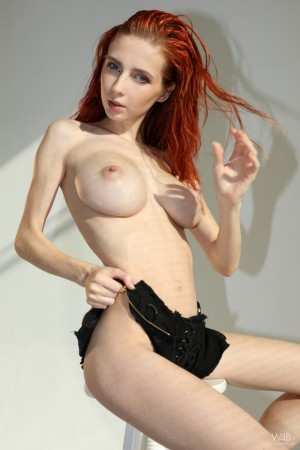 Ginger chick teases shaved pussy on camera