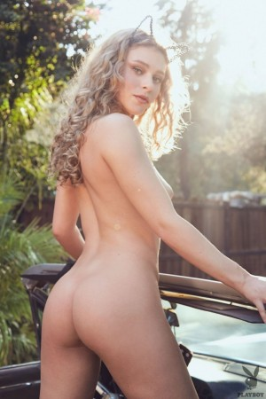 Totally naked hottie poses in the posh car