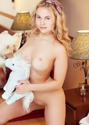 Curvy blonde babe plays with her favorite plush unicorn