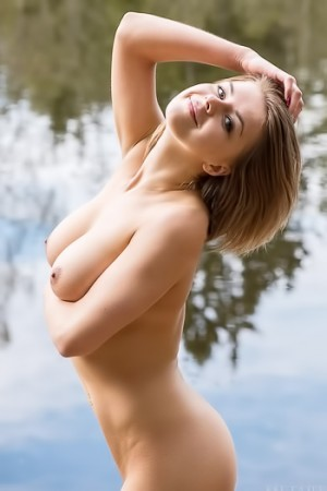Blonde with short hair and big tits naked at the lake