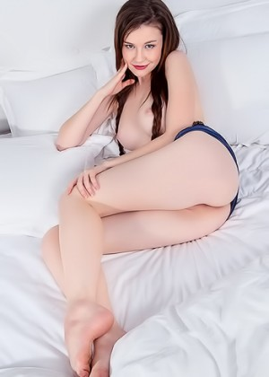 She has a fresh smooth pussy and long sexy feet on her legs