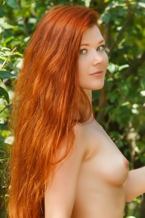 This red head MILF beauty is giving us all she's got